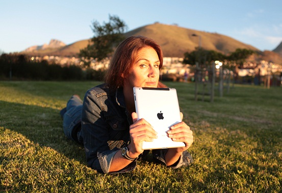 Nat with iPad on grass
