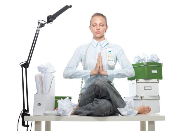 Woman meditating at office table