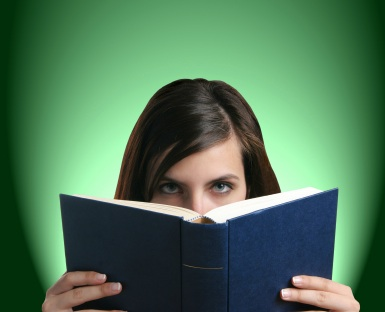 Woman behind book